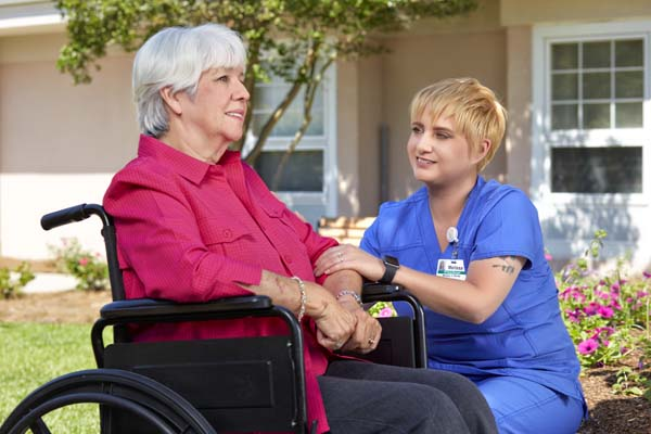 Nursing Staff Member With Patient